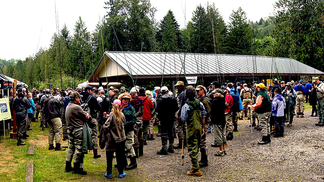 A huge crowd gathers for the $10 four Spey casting class at the Sandy River Spey Clave in Oxbow Park on the Sandy River in Oregon.
