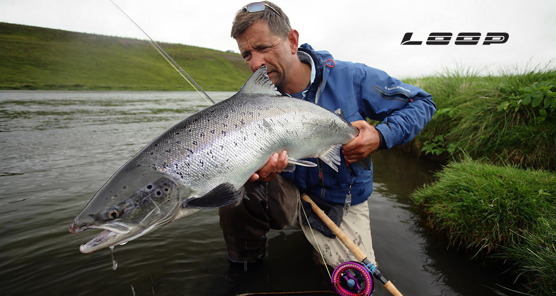 klaus fimor of the Loop Tackle company picturedh here with a fine Atlantic Salmon caught with a Loop rod and reel.